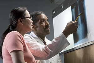 Doctor reviewing x-ray with patient.