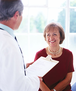 Woman talking with a doctor before she leaves the hospital