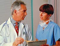 Picture of a doctor and nurse reviewing a patient