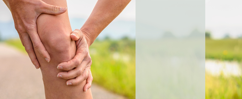 Closeup image hands grasping a leg in pain
