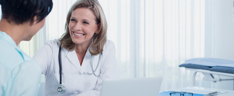 Healthcare provider and patient having a conversation