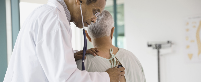 Older man having a lung cancer screening from his healthcare provider