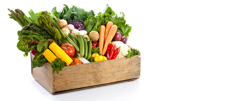 Wooden crate of colorful vegetables