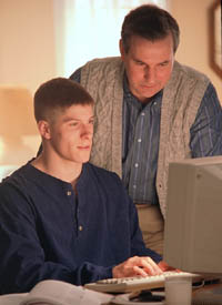 Picture of father and son at the computer
