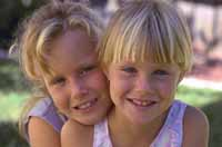 Picture of two young girls, giggling