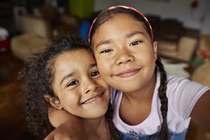 Two girls smiling.
